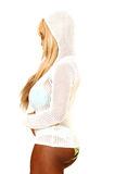 Sexy blond woman in bikini 88. An friendly blond woman in bating suit, high heels, and white net sweater Royalty Free Stock Photo