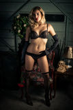 Sexy Blond Woman in Black Lingerie Royalty Free Stock Photography