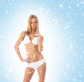 A sexy blond woman in erotic lingerie on a snowy background Royalty Free Stock Images