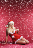 A sexy blond woman in erotic Santa lingerie Royalty Free Stock Image