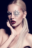 Sexy blond woman with fantastic makeup with bijou accessories Royalty Free Stock Photo