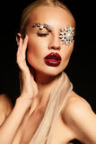 Sexy blond woman with fantastic makeup with bijou accessories Royalty Free Stock Image
