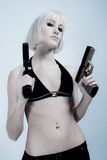 Sexy blond woman with guns Stock Photo