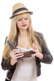 Sexy blond woman with handgun isolated on white Royalty Free Stock Images