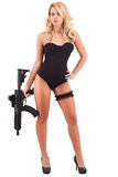 Sexy blond woman holding army weapon Stock Image