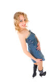 Sexy blond woman in jeans sarafan Royalty Free Stock Photo