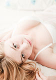 Sexy blond woman lay on bed Royalty Free Stock Photography