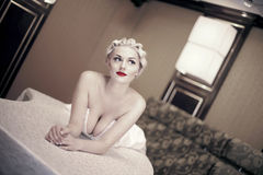 Sexy blond woman  laying Royalty Free Stock Images