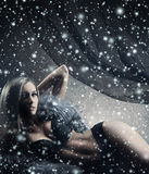 A sexy blond woman laying in erotic lingerie and fur Royalty Free Stock Image