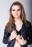blond woman with long hair in leather jacket with make-up Smokey Eyes stock images