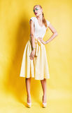 Sexy blond woman in long yellow skirt Stock Photo
