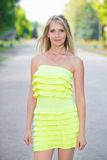 Sexy blond woman. Posing in yellow dress outdoors Royalty Free Stock Photos
