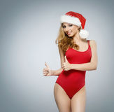 A sexy blond woman in red Christmas lingerie Stock Photos