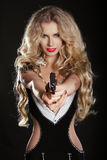 Sexy blond woman shooting gun Stock Image