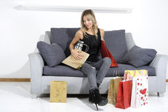 Sexy blond woman with shopping bags Stock Images