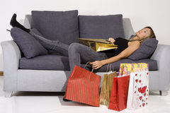 Sexy blond woman with shopping bags Royalty Free Stock Photography