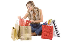 Sexy blond woman with shopping bags Royalty Free Stock Photos
