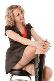 Sexy blond woman sitting on the bar chair Stock Photo