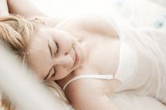 Sexy blond woman sleep on bed Stock Photography