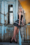Sexy blond woman standing front of an old house Stock Photo