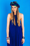 Sexy blond woman in ultramarine turban in overall Stock Photos
