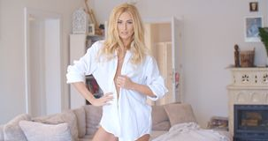 Sexy blond woman unbuttoning her shirt Stock Images