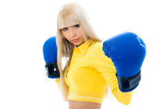 Sexy blond woman wearing boxing gloves Royalty Free Stock Image