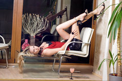 Blonde. Lying on the glass table stock photography