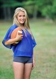 Sexy blonde active woman American Football Stock Photos