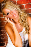 blonde against brick wall Stock Image