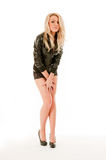 Sexy blonde ashamed woman in short skirt. Royalty Free Stock Photography