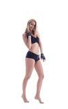 Sexy blonde Aufstellung in der Unterwäsche und in den Sporthandschuhen Stockbild