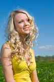 blonde   on background of green meadow Royalty Free Stock Images