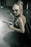 Sexy blonde ballerina dress and pistols Stock Images