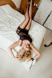 Sexy blonde in bed Royalty Free Stock Image