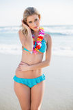 Sexy blonde in bikini wearing hawaii necklace posing Stock Photos