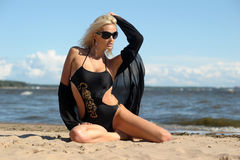 Sexy blonde in a black bikini Stock Photography