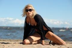blonde in a black bikini Stock Image