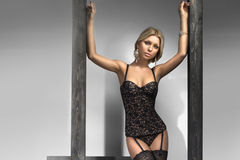 Sexy blonde in black lingerie Royalty Free Stock Photos