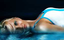 Sexy blonde in blue water. Picture of blonde near blue water Stock Photo
