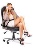 Sexy blonde boss making a call Royalty Free Stock Photos