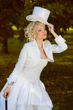 Sexy blonde bride. Sexy bride with a cane and a hat-cylinder Royalty Free Stock Photos