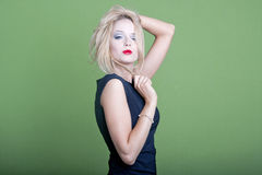 blonde businesswoman on green background Stock Photography
