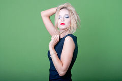 Sexy blonde businesswoman on green background Stock Photography