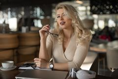 Sexy blonde businesswoman portrait. In cafe royalty free stock images