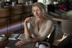 Sexy blonde businesswoman portrait. In cafe stock photos