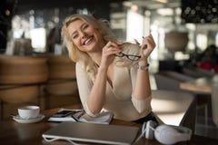 Sexy blonde businesswoman smiling portrait. Sexy blonde businesswoman portrait smiles in cafe stock photos