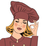 Sexy blonde chef woman in uniform  gesturing ok sign Royalty Free Stock Images