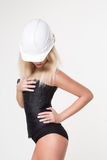 Sexy blonde in a construction helmet and a corset. Royalty Free Stock Image