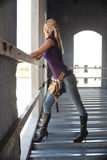 Sexy Blonde Construction Worker (4). A beautiful blonde with a tool belt in a partially completed commercial building Stock Photo
